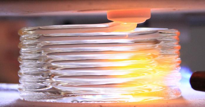 The 3D printer creates a molten glass work of art.