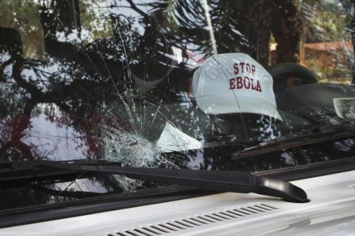 The broken windshield of an Ebola emergency team vehicle is seen after it had been pelted with stones in Lola February 9, 2015.