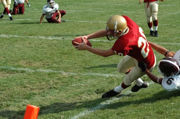 Football players who suffer concussions early in life can pay a steep price later.