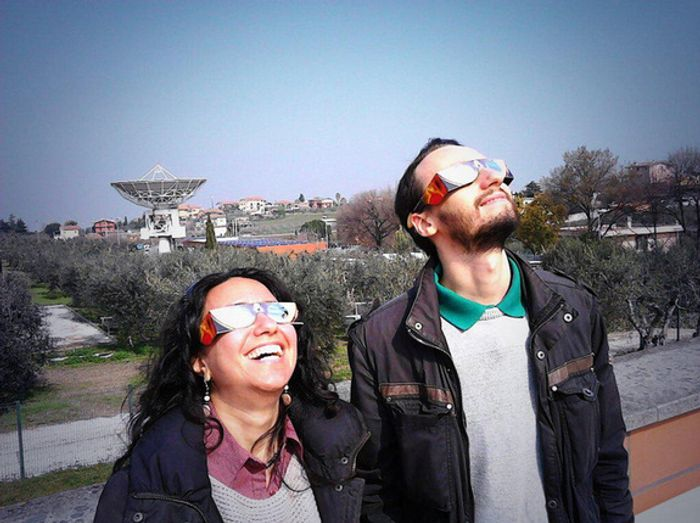 Eclipse enthusiasts watch from the ESA Earth Observation Center in Frascati, Italy.