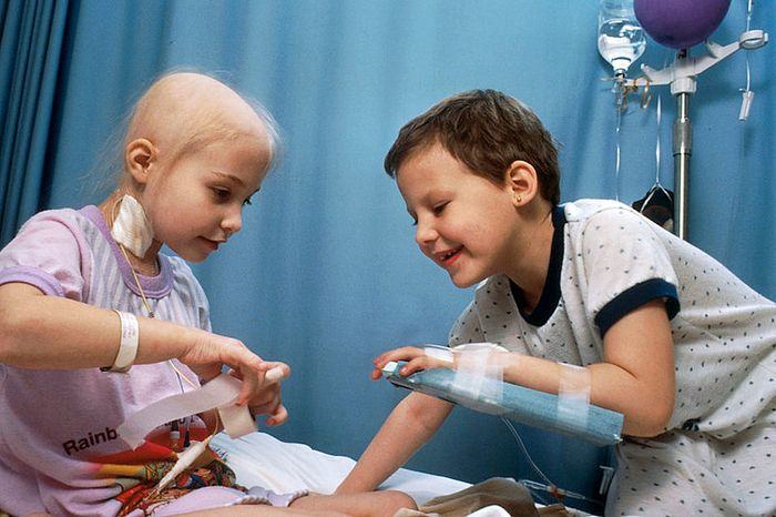 Two young girls with acute lymphocytic leukemia (ALL) receiving chemotherapy. Credit: National Cancer Institute