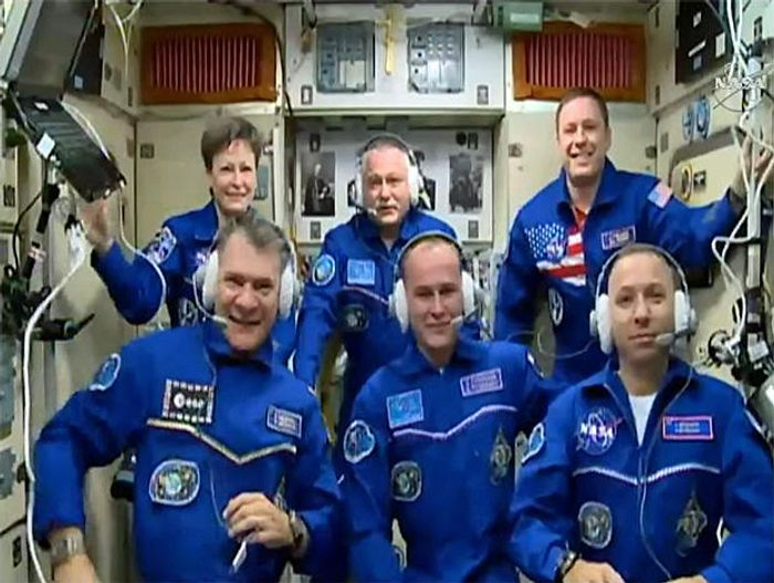 A group photo of the new and old astronauts/cosmonauts after the Soyuz spacecraft safely delivered three more men on Friday.