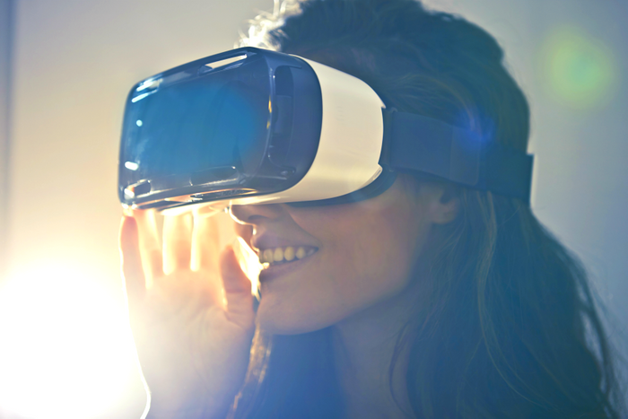 woman with VR headset, credit: public domain