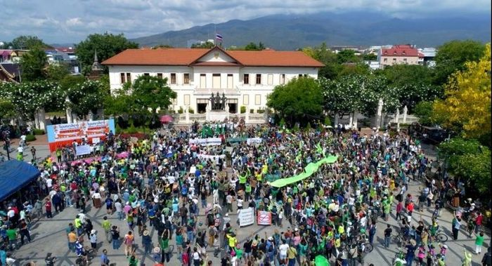 Many gathered to protest the housing development, showing their support with green ribbons. Photo: The Nation