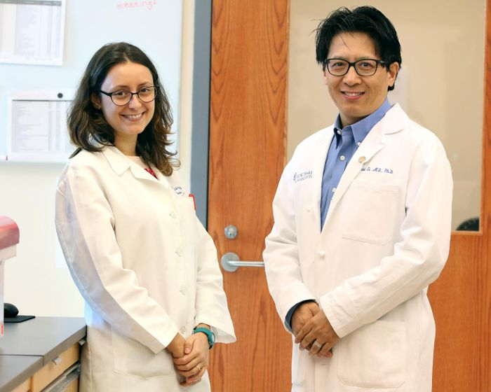 Graduate student Alessandra Metelli (left) and Zihai Li (right), MD, PhD, chair of the Department of Microbiology and Immunology at the MUSC Hollings Cancer Center. Source: Medical University of South Carolina