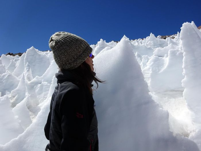 University of Colorado Boulder student Lara Vimercati examines a nieves penitente structure on Volcán Llullaillaco in Chile. / Credit: Steve Schmidt / University of Colorado Boulder