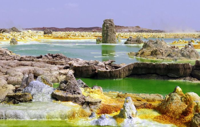 Hyperacid, hypersaline and hot ponds in the geothermal field of Dallol (Ethiopia). Despite the presence of liquid water, this multi-extreme system does not allow the development of life, according to a new study. The yellow-greenish colour is due to the presence of reduced iron. / Credit: Puri López-García