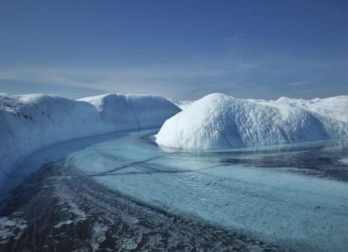 A supraglacial stream and sediment floodplain in southwest Greenland. / Credit: Sasha Leidman