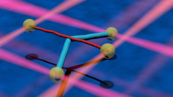 Two filaments (cyan and red) linked to microscopic beads (yellow). Laser beams help hold the particles in place (orange and red lines). The filaments cross and then move over each other. The interaction can be so strong that one filament bends (blue). / Credit: Markus Osterhoff, Institute for X-ray Physics