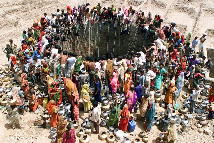 People gather to fetch water from a huge well in the village of Natwarghad in the western Indian state of Gujarat. Photo: Reuters