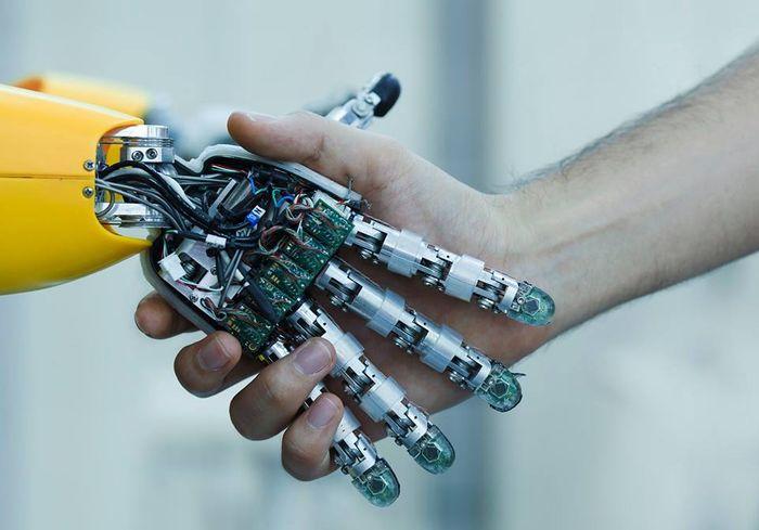 Robot and human hand, credit: Sachin Lulla public Facebook photo (facebook.com/SachinLulla.IBM/)