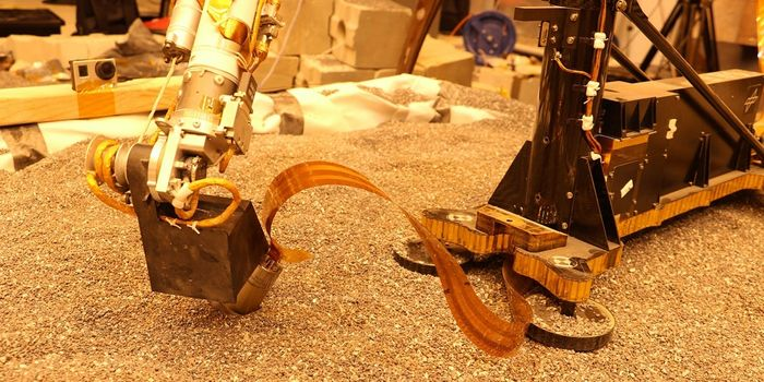 A demo shows an identical robotic arm pressing down on a near-identical mole during testing.