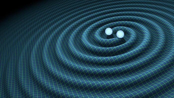 An artist's impression of gravitational waves as two large objects orbit one another before crashing into each other.