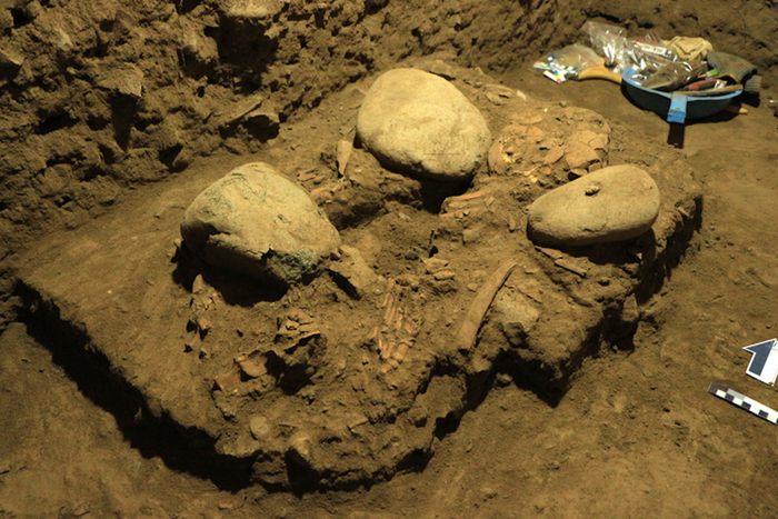 Excavations at the Leang Panninge site, and the skeleton as found. / Credit: Hasanuddin University, Indonesia