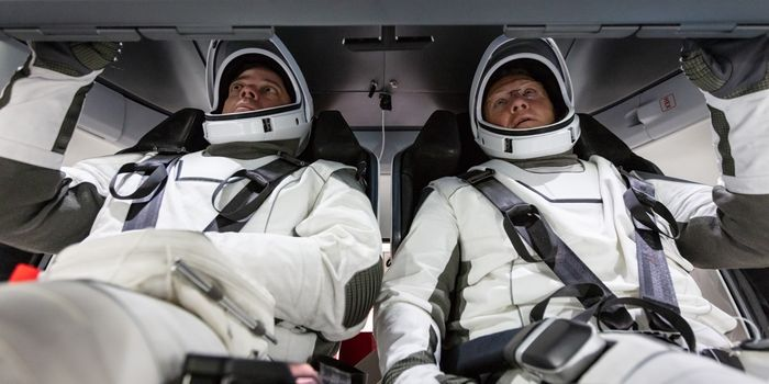 NASA astronauts Doug Hurley and Bob Behnken inside of the SpaceX Dragon spacecraft.