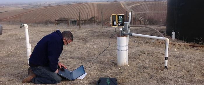 Scientist taking groundwater measurements. The new technique introduced in this study gives much more accurate readings. Photo: Cal Alumni Association - UC Berkeley