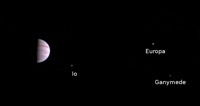 Jupiter and three of its moons, as soon from the JunoCam.