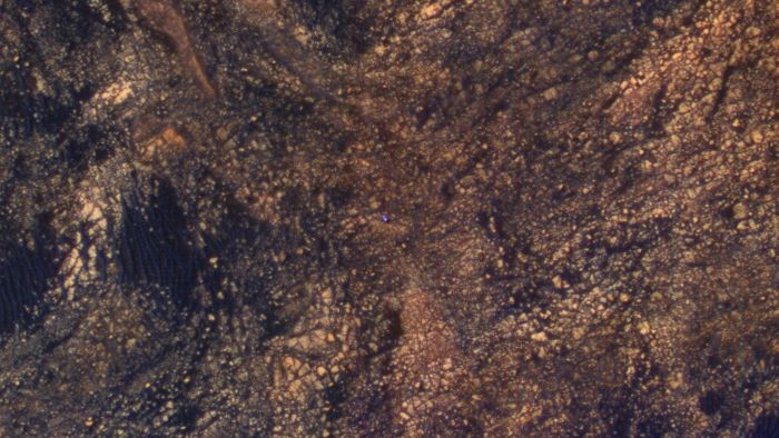 This new photograph, taken by the Mars Reconnaissance Orbiter, shows the Mars Curiosity Rover trekking the surface.