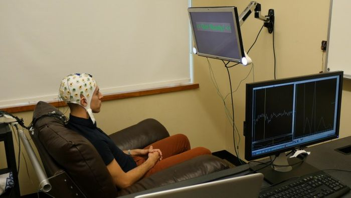 A test subject is wired up for a brain experiment