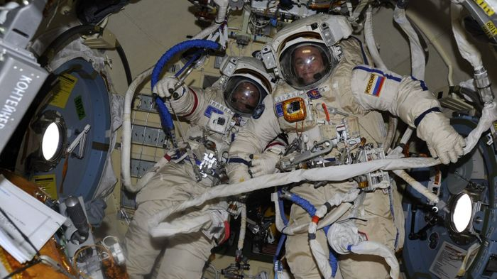 Russian Cosmonauts Fyodor Yurchikhin and Sergey Ryazanskiy pose for a picture just before their spacewalk on Thursday.