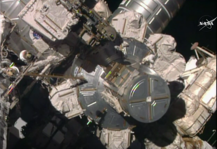 An astronaut performs repairs on the ISS Monday morning.