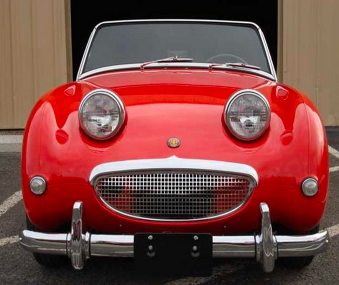 An example of a car's grille that looks like it has eyes and a mouth, despite not being designed to have a face.
