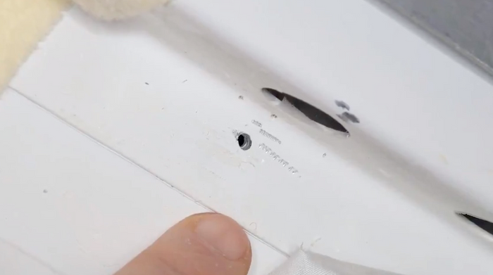 A close-up of the hole from the inside of the spacecraft.