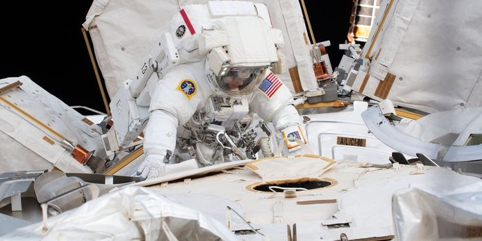 An astronaut performing a spacewalk outside of the International Space Station.