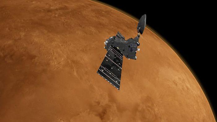 An artist's impression of the ExoMars Trace Gas Orbiter orbiting Mars.