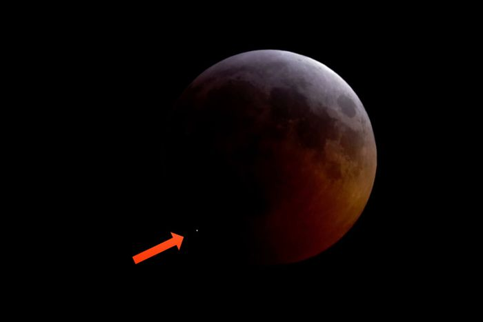 In this image, we see the white dot on the lunar surface depicting the unexpected meteorite strike during this past weekend's lunar eclipse.