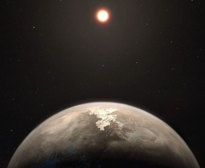 An artist's impression of Ross 128 b and its host star, a red dwarf called Ross 128.