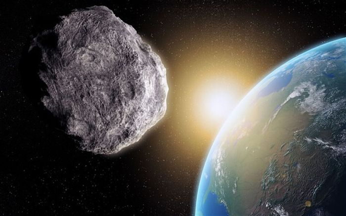 Asteroid 2013 TX68 will pass Earth this weekend, although it's still unclear how close it will be to us.