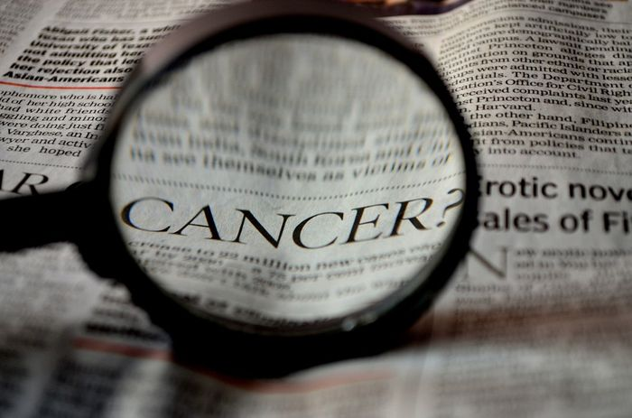 Cancer in newspaper image, credit: public domain