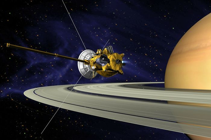 An artist's rendition of the Cassini probe orbiting Saturn.