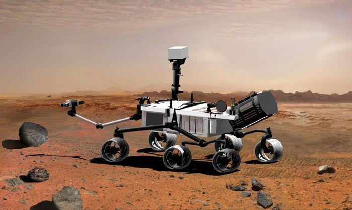 An artist's rendition of NASA's Curiosity Rover trekking Mars' surface.