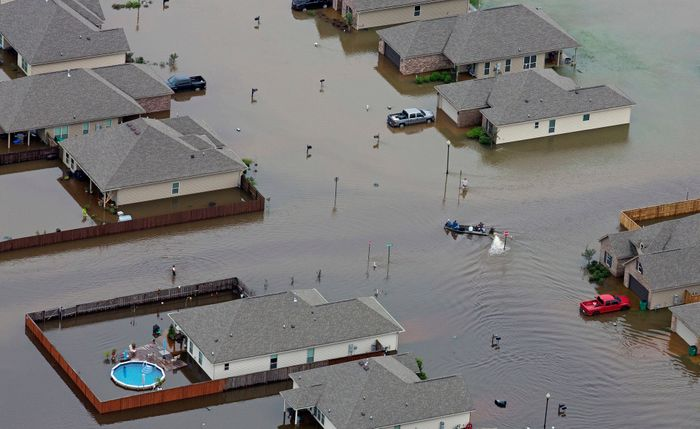 Boats motored along flooded streets in Hammond, La., on Saturday. Credit Max Becherer/FR 171354AP, via Associated Press..