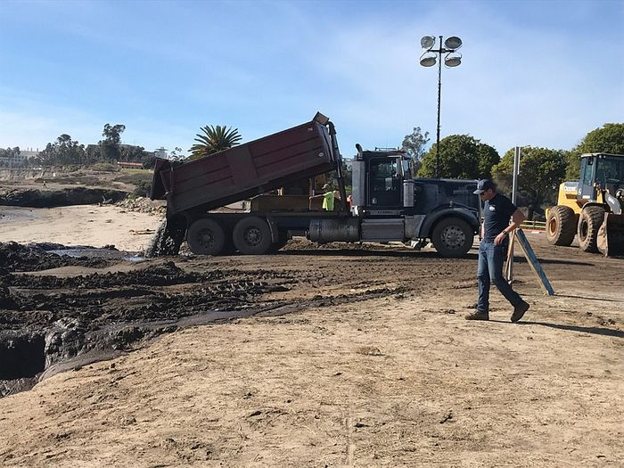 A truck dumps mud onto Goleta Beach. Photo: The Santa Barbara Independent