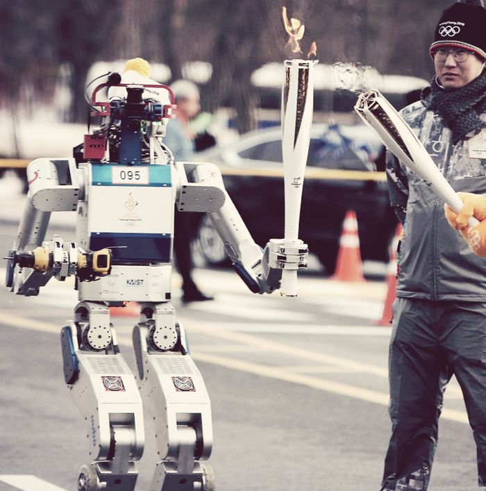 HUBO the robot receives the Olympic flame, credit: still from On Demand News, YouTube