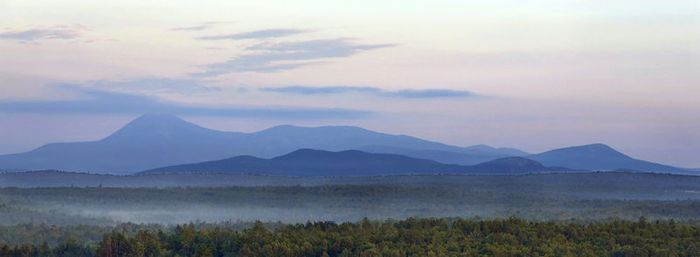 Early morning haze colors Mount Katahdin and its surrounding mountains as seen in 2014 from a height of land along Route 11 in Patten, Maine. The viewpoint is part of the Katahdin Woods & Waters scenic byway. Gregory Rec/Portland Press Herald via Getty Images
