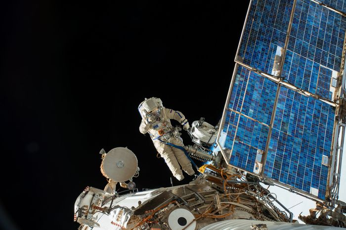 Two cosmonauts performed a spacewalk on Tuesday to study the site of the mysterious hole that caused an air leak in August.