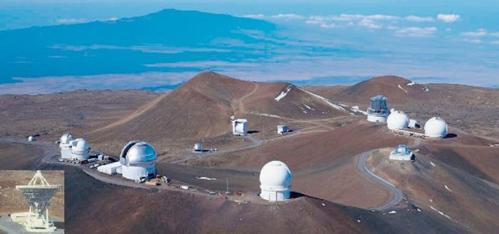 Telescopes peep out from Mauna Kea. Photo: Institute for Astronomy