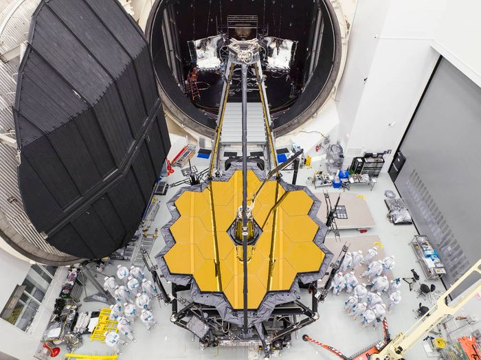 NASA engineers stand by the James Webb Space Telescope's heart in front of Chamber A.