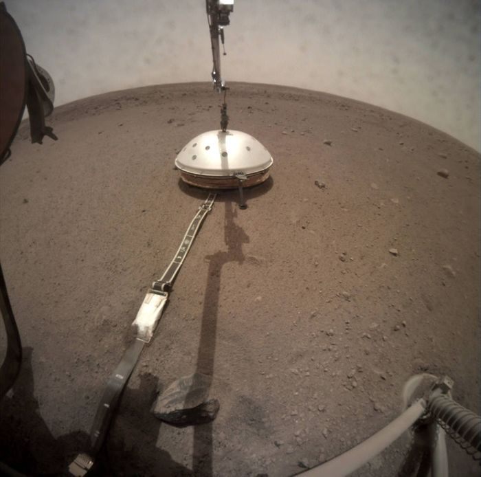 A view of InSight's SEIS instrument following the installation of its Wind and Thermal Shield.
