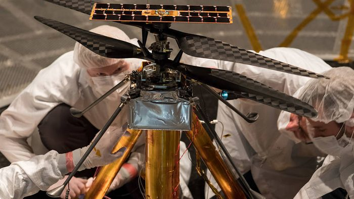 Engineers worked on the Martian helicopter before deploying the first test flight.