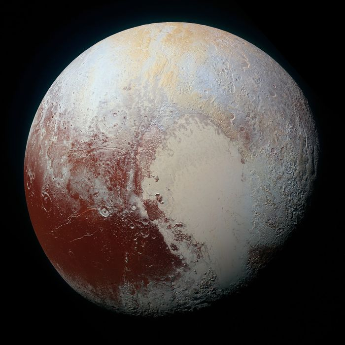 This image shows the brown and red deposits al over Pluto's surface.