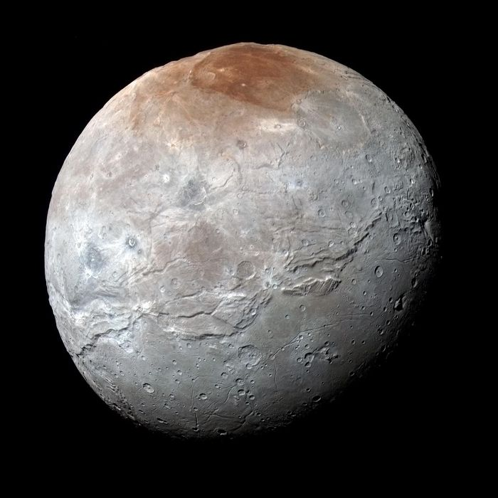 Where did that distinctively-colored red spot at the top of Charon actually come from? Scientists think they've figured it out.