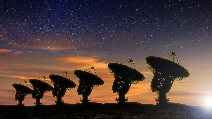 SETI uses an array of radio signal antennas to listen for sources of radio activity from space.