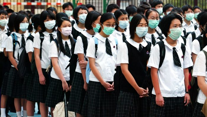 Students wear masks during a SARS outbreak. South China Morning Post