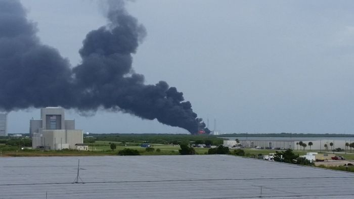 Image shows SpaceX's Cape Canaveral, Florida headquarters billowing with smoke after a Falcon 9 static test fire goes awry.