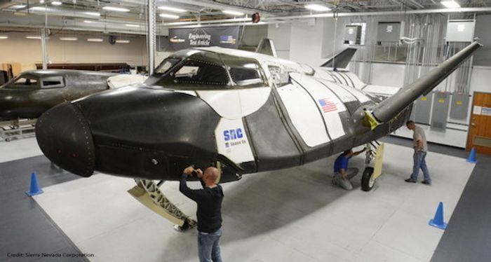 Technicians with the sub-orbital version of SNC's Dream Chaser